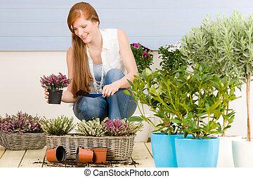 Summer garden terrace redhead woman with flowers - Summer...