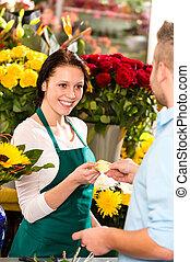 Smiling florist man customer buying flowers card - Smiling...