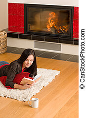 Home fireplace happy woman read book winter - Happy young...