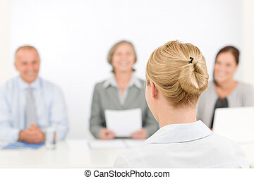 Job interview young woman with business team - Business...