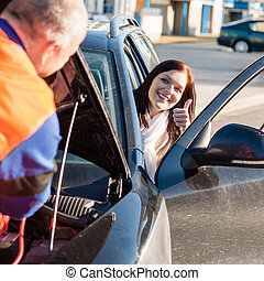 Mechanic fixing car happy woman thumb up breakdown problem