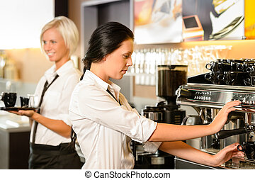 Staff at cafe making coffee espresso machine woman working...