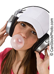 Female teenager with bubble gum and headphones - Smiling...