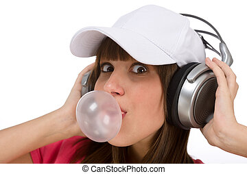 Happy teenager with bubble gum and headphones - Female...