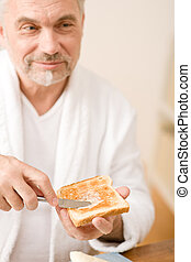 Senior mature man having breakfast toast - Senior mature man...