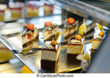 Cake and pastry in window display canteen food dessert tasty