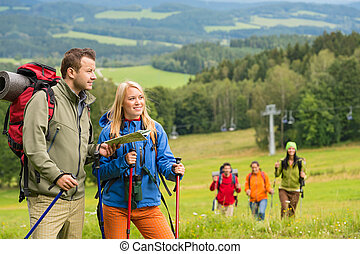 Young hikers reading map in natural landscape - Young hiker...