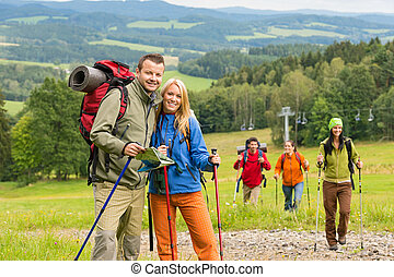 Posing hiker couple with landscape background - Smiling...