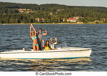 Young friends enjoying summer on speed boat - Young friends...