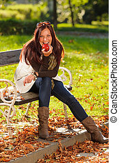 Autumn attractive woman eat apple sunset park - Autumn...