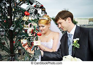 Happy bride and groom at wedding walk on Luzhkov bridge -...