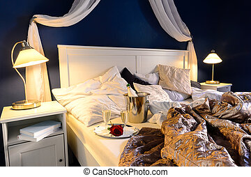 Rumpled sheets hotel bedroom romantic night - Rumpled sheets...