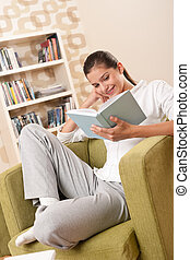 Students - Female teenager reading book