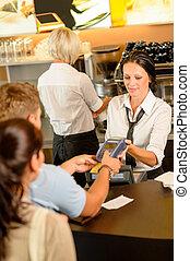 Man paying bill at cafe using card bill happy waitress