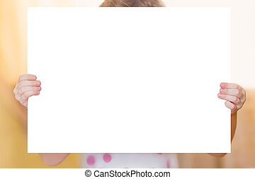 Little girl with white flipcharts in hands.