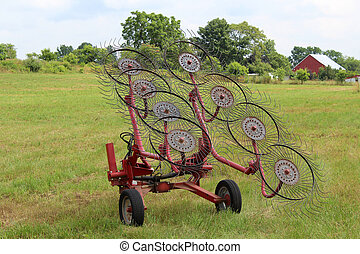 Hay Rake in Field - A hay rake in a farm field