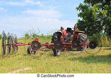 Tractor in Field with Hay Rake