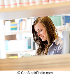 High school library student woman read book - Young student...