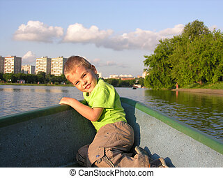 child on boat