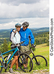 Young cyclists with mountain bikes during summer weekend -...