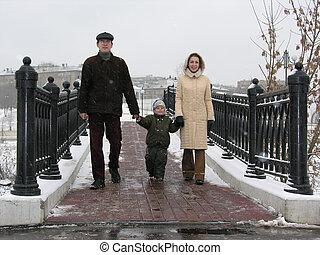 family on winter bridge