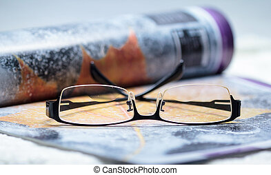 Eye glasses on the magazine