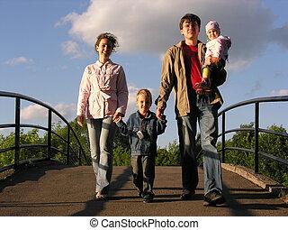 family on bridge