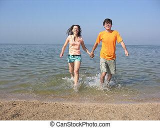 couple run on beach