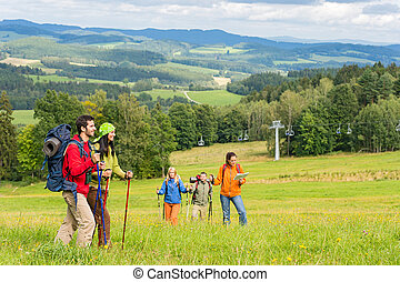 Young trekking people enjoying scenic landscape - Young...