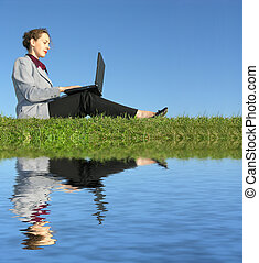 businesswoman sit with notebook and water