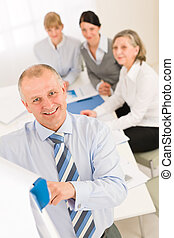 Giving presentation businessman point flip-chart - Giving...