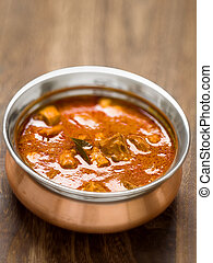 spicy indian mutton curry - close up of a bowl of spicy...