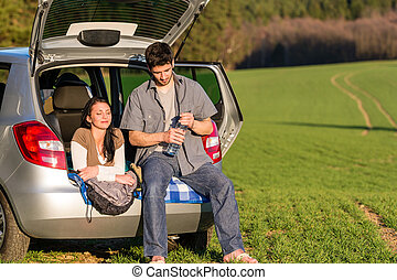 Camping couple inside car summer sunset countryside - Happy...