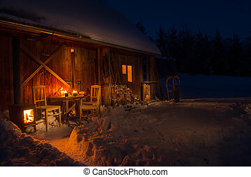 Cozy wooden cottage in dark winter forest snow countryside