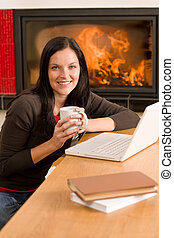 Home living woman with laptop by fireplace - Happy woman at...