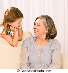 Grandmother and granddaughter look at each other