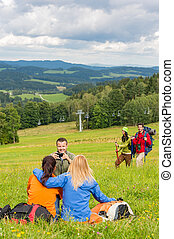 Hiking friends taking picture in scenic landscape - Young...