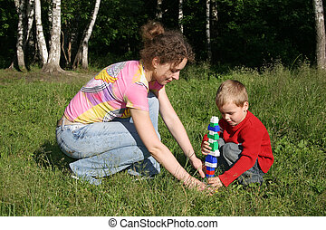 mother with child play in park