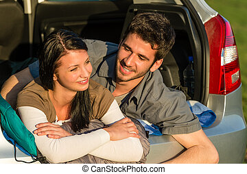 Camping young couple lying car summer sunset - Camping young...
