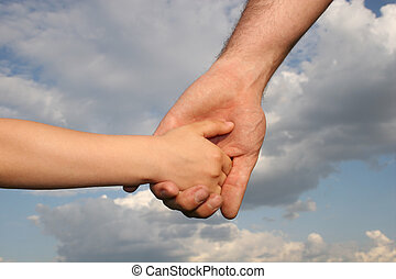 father\'s and son\'s hands