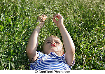 Child lying in the grass