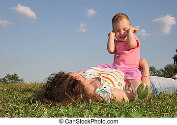 mother with baby on grass