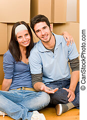 Moving new home young couple hold keys - Moving into new...