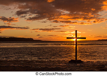 Cross Of Hope - Cross at sunset with the sun setting right...
