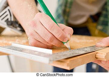 Home improvement - handyman prepare wooden floor in workshop