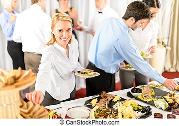 Business woman serve herself at buffet catering service...
