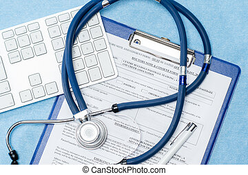 Stethoscope laying over doctors emergency report medical...