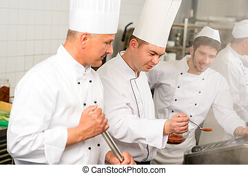 Two male cook work in professional kitchen - Two male cooks...