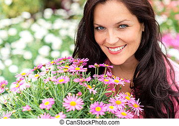 Portrait of beautiful woman with purple flowers