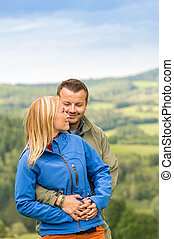 Lovely young couple hugging with scenic view - Lovely young...